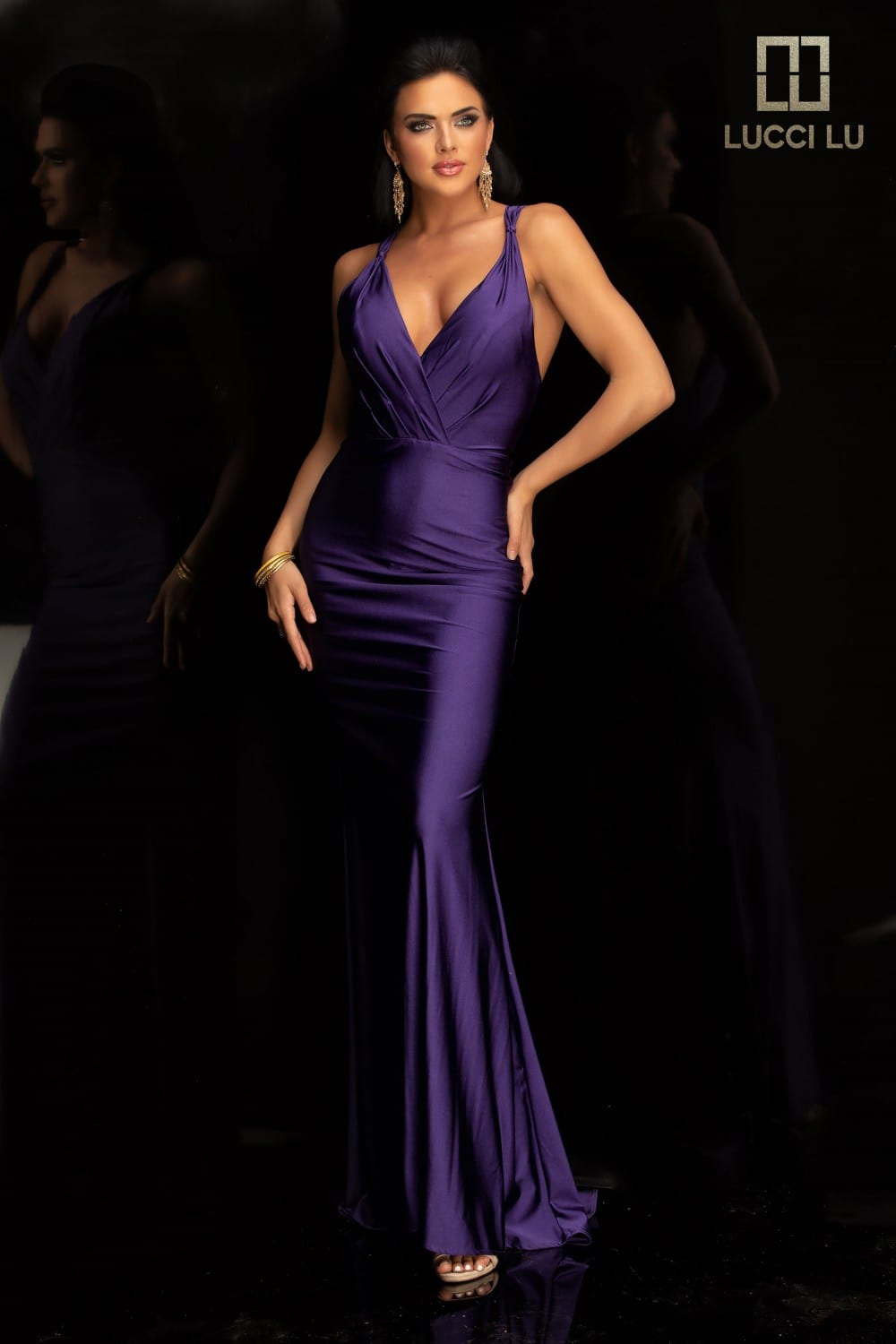 Beautiful fitted dress with low warped plunge bodices with a cross-cross back, and trainBeautiful fitted dress with low warped plunge bodices with a cross-cross back, and train