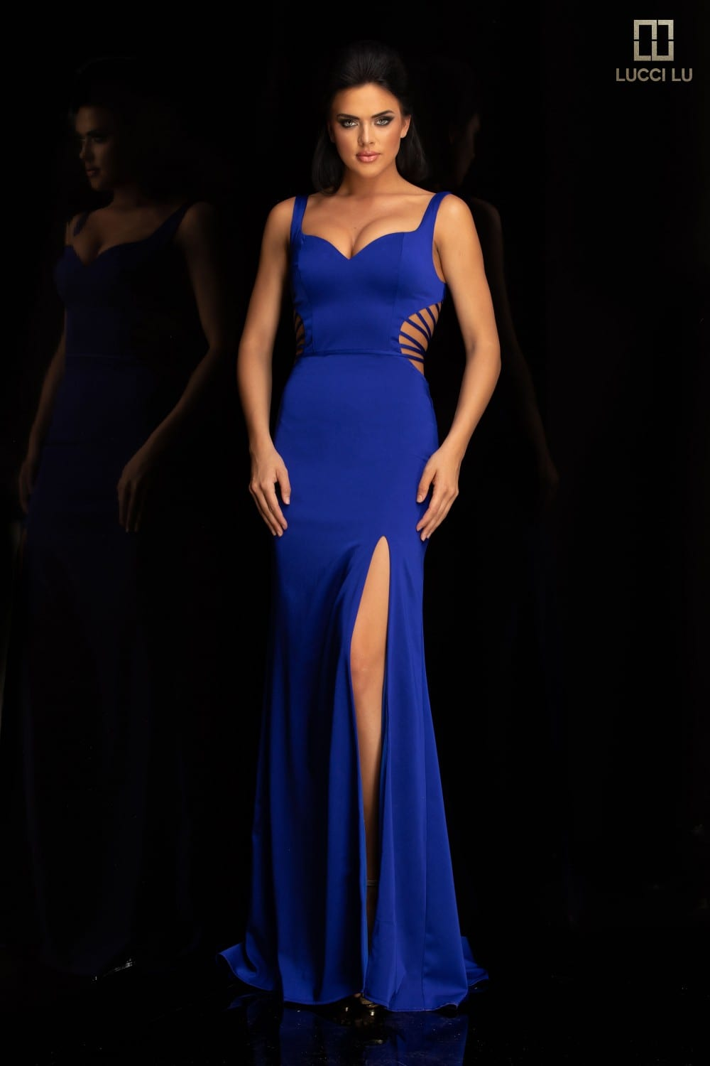 Fitted gown featuring a sweetheart bodice and ladder cut sides with a slit.