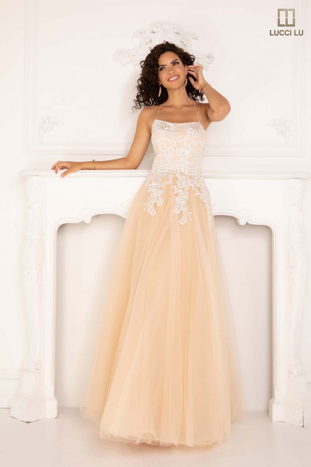 Elegant ballgown with lace floral pattern, a lace-up back, and tulle.Elegant ballgown with lace floral pattern, a lace-up back, and tulle.