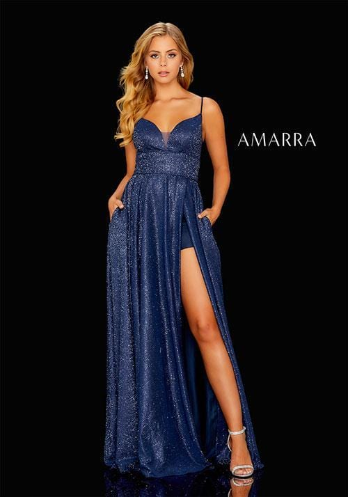 Shimmer gown with a sweetheart neckline, high slit with a snap, skirt underneath, and an open back.