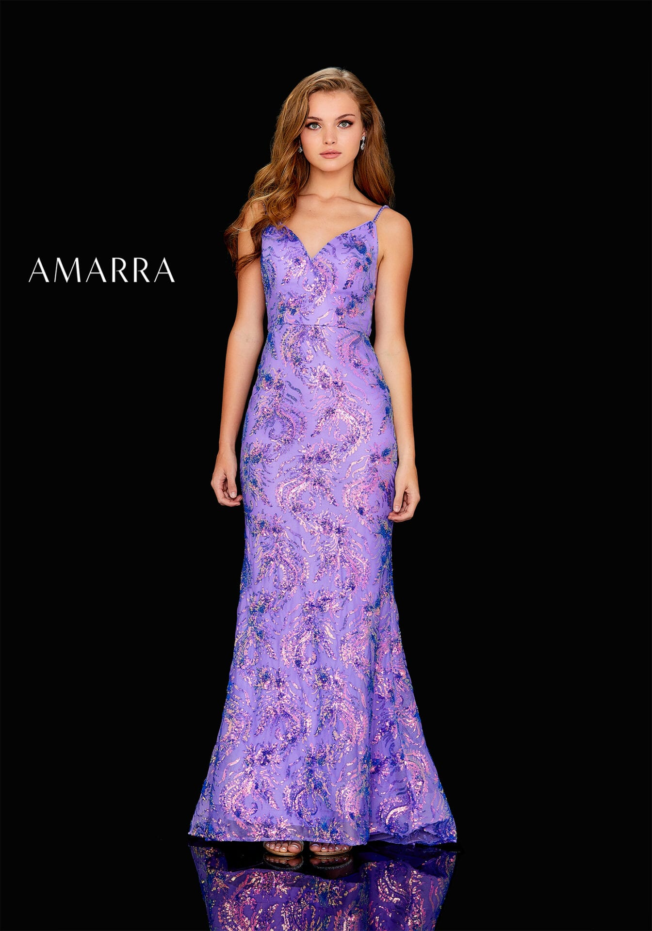 Fitted gown with a sweetheart neckline, embellished straps, and iridescent dragon sequin pattern.