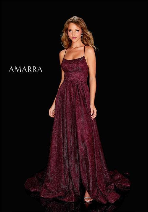 Glitter Jersey gown featuring a scoop neckline, seamed waist line with piping, slit skirt with a snap, and deep lace up back.