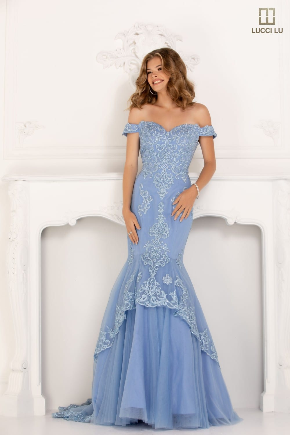 Fit and flare off-the-shoulder gown with embroidered lace, and a tulle bottom.